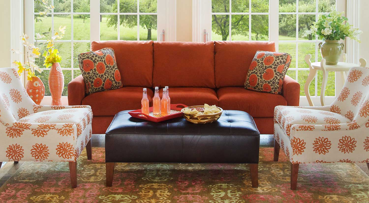 living room with orange couch circle furniture ottoman ottomans boston 21066